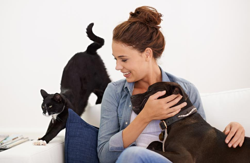 Woman loving her dog and cat